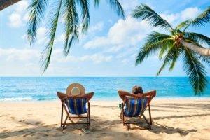 Couple relax on the beach enjoy beautiful sea on the tropical island. Summer beach vacation